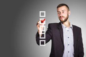 A man choosing the key for a multiple choice quiz